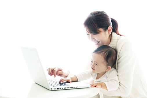 mother and baby using notebook PC